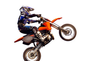 young moto rider in the air isolated on white